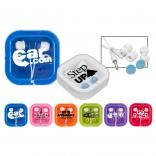 Traveling White Ear Buds with Brightly Colored Accents
